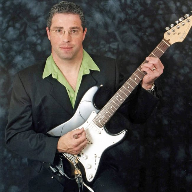 Gordon Hughes Is A Singer Guitarist And Bass Guitarist