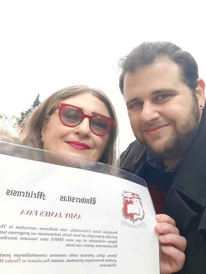 A picture of Mother and I on my graduation day.