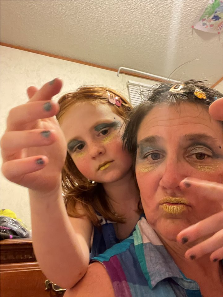 """Me (Laura) and daughter Savannah acting silly doing """" makeovers"""""""