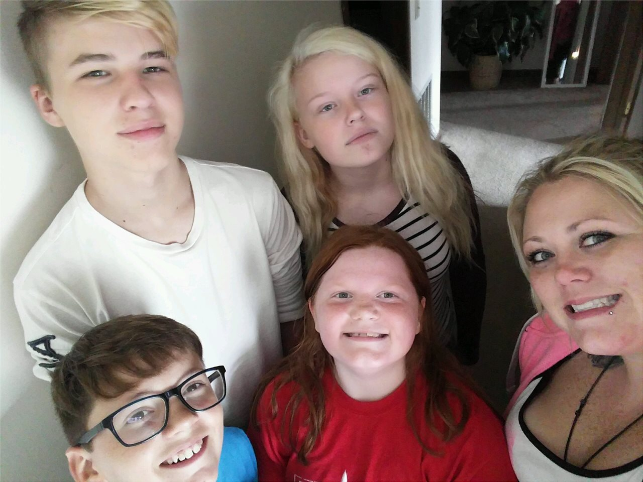 Top left to right. Son, daughter, under her is step daughter right of her is my girlfriend. Kid with