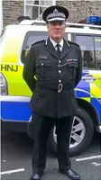 Police Assistant Commissioner. own uniform, Chris Wilson. high rank, drama, movie, film, tv, officer