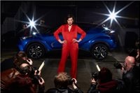 """Performing in Toyota's """"The Night That Flowed"""" as Paparazzi (far left) photographing Milla Jovovich."""